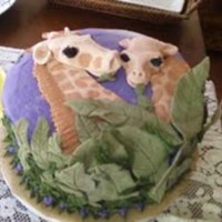 Mother And Baby Giraffe Mother and baby Giraffe made of fondant. Icing is buttercream. Cake is strawberry with strawberry-n-cream filling. Leaves were a mixture of...