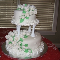 White Wedding Cake White wedding cake with white fondant roses. Similar to the Wilton design.