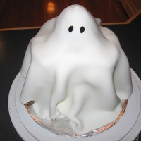 Ghost 3D ghost cake. Thanks to the inspiration found here. Made box cake with buttermilk to make a denser cake to hold up the fondant.