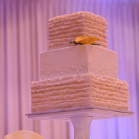 Ruffled Square Wedding Cake My client came to our consultation with one, yes ONE, computer printed image in her hand. This is the cake she wanted. And I was very happy...