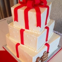 Almond Cake With Kahlua Bc Filling And Chocolate With Rasp Filling This Cake Was For A Beautiful Fun Christmas Themed Wedding Gingerbrea Almond cake with Kahlua BC filling, and chocolate with rasp filling, this cake was for a beautiful, fun Christmas themed wedding....