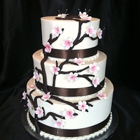 Cherry Blossom Wedding Cake Gumpaste blossoms dusted with pink centers, and dark chocolate fondant branches.