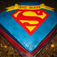 40Th Superman Birthday Made with 10in. square. Slanted the front of the cake to show logo.