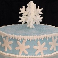 Snowflake Cake B/c icing w/ fondant cut out snowflakes. Topper is royal icing 3-D snowflake covered in decorating sugar.