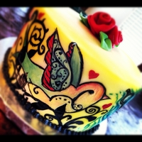"Tattoo Cake 8"" chocolate cake with BC fondant. Hand painted tattoo design and Fondant roses on top. Airbrushed yellow."