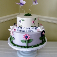 Flowers & Butterflies   Girly cake for cousins that share close birthdays. Cake iced in bc, decorations & butterflies are fondant.