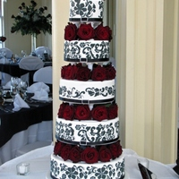 Black, White & Red Elegance  All tiers fondant covered and then stenciled with RI in a design similar to that on the bridesmaid dresses. Nerve wracking set up but worth...