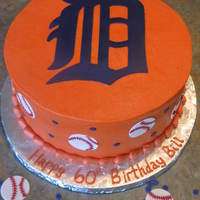 "Detroit Tigers Three vanilla 9"" layers covered in American buttercream. I used my Silhouette Cameo to cut the Tigers logo, the baseballs and the blue..."