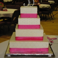 Oil Bleeding Into Fabric Ribbon Here's an example of oil bleeding from buttercream into fabric ribbon. All the ribbon on this cake had been backed with wax paper,...