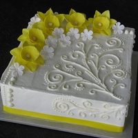 "Spring Daffodil Cake A rustic spring cake with scrolls and gumpaste flowers. White 10"" square cake with raspberry filling, iced in white chocolate IMBC."
