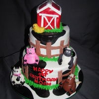 Barn Cake Barn is rkt covered in fondant, with fondant animals and cow print painted on with black gel color and vodka.