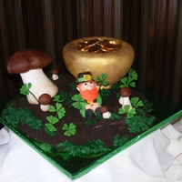 St Patrick's March Birthday cake - I found a darling Leprechan someone did in fondant and tried to replicate it for this cake, I wish I knew who did the...