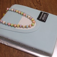 Sister Missionary Cake  The fondant necklace is in Young Woman's colors, the inscription on the side reads:Mis-sion-ary: noun: Someone who leaves family for a...