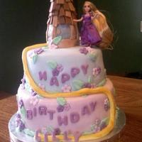 Tangled Theme Cake Covered In Rolled Buttercream Tangled theme cake covered in rolled buttercream.
