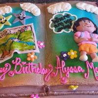Dora The Explorer Book Cake *Frosted in buttercream, Airbrushed with fondant figures
