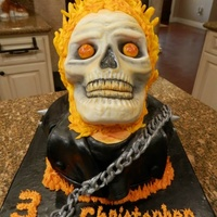 Ghost Rider Cake Cake is vanilla with bc icing, covered in fondant with modeling chocolate hair and chain and hand painted details.