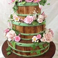 Flower Barrels With Roses 3 tiered wedding cake is all strawberry and vanilla marbled cakes, with bc icing, covered in fondant with hand painted, fondant boards and...