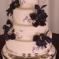 Dark Purple Wedding Cake   Purple orchids and roses, with hand-painted scrolls.