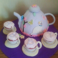 Teapot With Cupcake Teacups This teapot cake was for a little girls 4th birthday. She wanted something with a kitty and her mom was doing a tea party for her birthday...