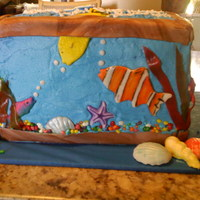 Aquarium This cake is German Chocolate with caramel filling between the layers. My 14 year old daughter made the shells and fish (the small fish...