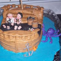 Pirate Ship This is a pirate ship I did for my god sons, they both love pirates and so this was my back to school cake for them. They loved it!!! This...