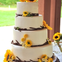 Summer Harvest Inspiration Challenge Modern rustic wedding cake with gum paste sunflowers, ranunculus, and billy balls.