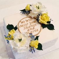 Floral Retirement Cake Simple, floral cake for two co-workers who are retiring. Fondant covered cake with piped royal icing dot design on the side. Plaque made...
