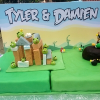 Working Angry Birds Cake Working Angry Birds cake for 4 year old twins Tyler and Damien. Birds and Pigs are all edible made of fondant (but let the kids know that...