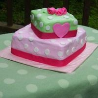 Pink And Green W/ Polka Dots/heart I did this one for my neice's 4th bday. Buttercream w/ fondant dots, heart and roses. Ribbon trim.
