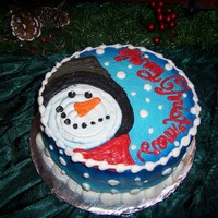 Frosty The Snowman Red Velvet Cake decorated in crusting cream cheese icing! Have a Merry Christmas!