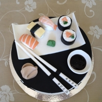 Sushi Cake 9''vanilla cake decoraded with gumpaste. all edible. sushi plate with sushi peices on top, salmon, rolls, shrimps and shopsticks....