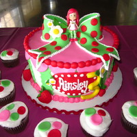 "Strawberry Shortcake For Ainsley I made this for a 3 year old who loves Strawberry Shortcake. It is a 9"" round strawberry cake with buttercream fill. The background is..."
