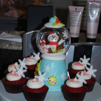 Frosty The Snowman  Copied an idea I saw here of making a snowglobe cake. It is a mini cake made from a jumbo cupcake. It was the centerpice for the cupcakes...