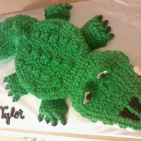 "Alligator Cake   Carved this cake from small sheet cake and 8"" round. Used cupcakes cut in half for feet."