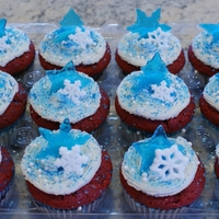 Snowflake Cupcakes Red velvet cupcakes topped with buttercream icing. I made the blue star, tree and snowflake decorations from melted Jolly Rancher candies...