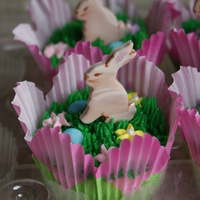 Easter Cupcakes The bunnies were cut from swirled gumpaste and I painted a few details on them, attached toothpicks for placement and made little royal...