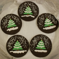 Christmas Tree Cookies These are chocolate cookies with a gum paste tree adhered to them. (I tried piping trees with royal icing like in the photo I saw, but I&#...