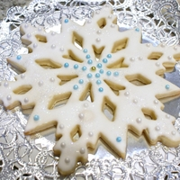 "Snowflake Cookie I cut large (8"") snowflake cookies, covered with royal icing and accented them with dragees and a pinch of edible glitter. I ""..."
