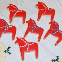 These Are Sugar Cookies With Royal Icing Decoration And Gold Dragees As Hoof Accents They Are Decorated To Look Like Swedish Dala Horses W... These are sugar cookies with royal icing decoration and gold dragees as hoof accents. They are decorated to look like Swedish Dala horses,...