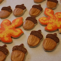 Autumn Cookies These are decorated with royal icing. The acorns were painted with a little gold luster dust.