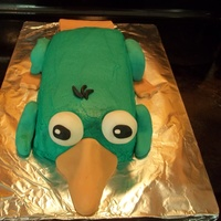 Perry The Platypus Perry the Platypus from Phineas and Ferb. The cake batter was tinted to match the frosting and fondant outside for my 2 year old grandson....