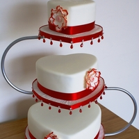 Red And Ivory Heart Wedding Cake 3 tier Red and ivory heart wedding cake with open rose and beaded board