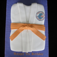 Karate Gi Cake   Karate uniform cake. The cake was shaped out of a sheet cake and covered and decorated with fondant.