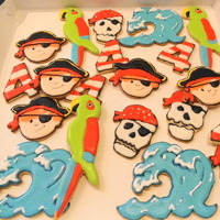 Pirates! PIrates for my son's 4th birthday. The wave and the 2 pirate variations are from ecrandal.....designed by GeminiRJ, KimsMom76, and...