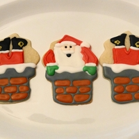 Santa Cookies From a Sweet Sugar Belle tutorial.......gotta love her!