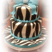 Zebra And Turquoise 9 year old daughter's birthday, a little bit out of practice on this one. I haven't done a cake in more than a year : /