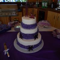 "12 8 6 Buttercream Frosted With Purple Ruffles Halfway Up The Sides Decorations Handmade By Bridal Couple 12"", 8"", 6"" Buttercream frosted with purple ruffles halfway up the sides. Decorations handmade by bridal couple"