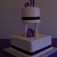 "10 Square With A Round 6 Top Tier Real Ribbon And Artificial Flowers 10"" square with a round 6"" top tier. Real ribbon and artificial flowers."