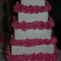 Wedding Cake With Over 100 Fresh Roses! 5 tiered wedding cake with real roses. 1 tier is 'fake' since they didn't have that many guests but the bride still wanted...