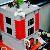 Ghostbuster Fire House My nephew loves the ghostbusters!! Made this for him. :) We had lots of fun with it. Its covered in buttercream and decorated with mmf. :)...